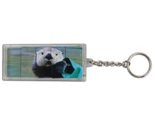 Rectangle sliding sea otter key ring.