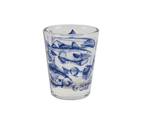 Clear shot glass with a school of fish designed around the glass.