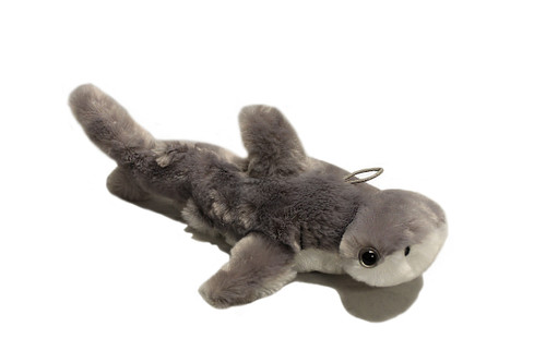 Grey hammerhead stuffy with a shiny fur and white bottom.