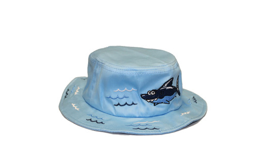 Light-blue bucket hat with a shark and bubbles designed on the rim and top of the hat.