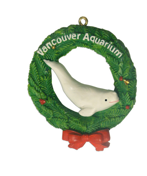 Christmas ornament with wreath and beluga whale