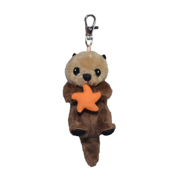 Cute small sea otter key ring holding a red star