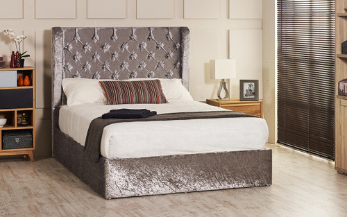 Orchid ottoman wing bed shown in silver crush velvet fabric with diamante buttons