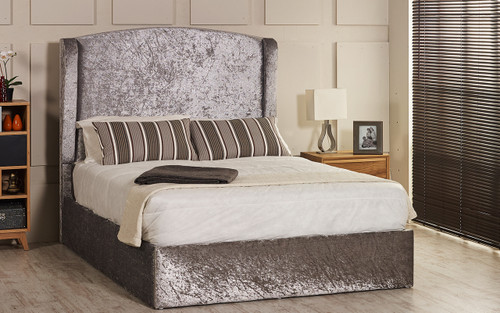 Seville ottoman wing bed shown in silver crush velvet fabric with diamante buttons