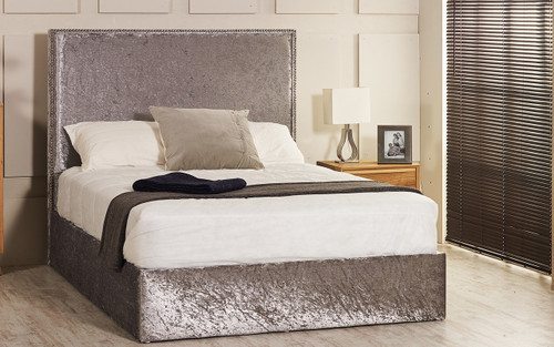 Vicenza ottoman bed shown in silver crush velvet fabric with diamante buttons