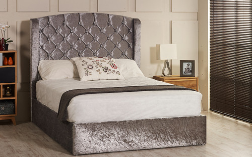 Adana ottoman wing bed shown in silver crush velvet fabric with diamante buttons