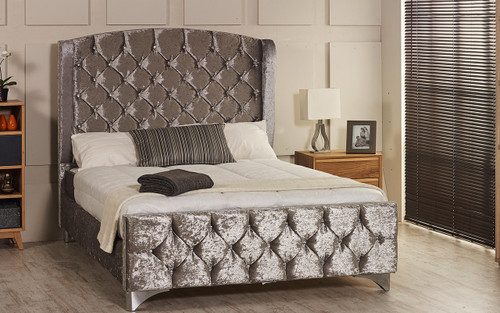 Tula Wing Back upholstered bed frame shown in ice crush velvet fabric with diamante button and chrome  feet. The Esupasaver Bed Company Quality Beds Made in England