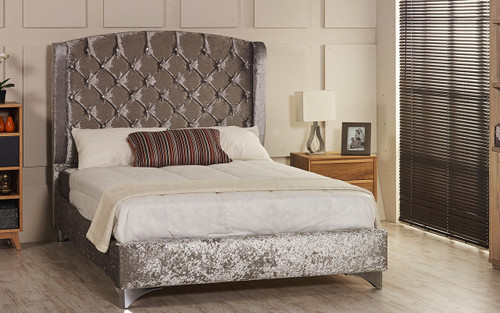 Tver Wing Back upholstered bed frame shown in ice crush velvet fabric with diamante button and chrome  feet. The Esupasaver Bed Company Quality Beds Made in England