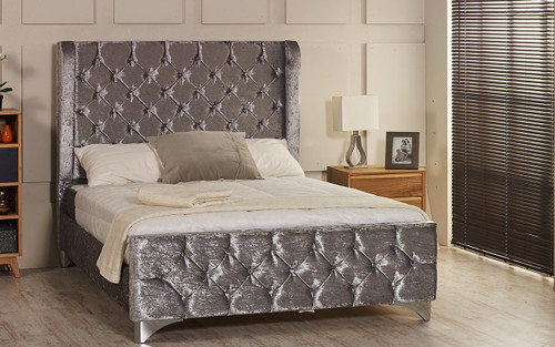 Sparta Wing Back upholstered bed frame shown in ice crush velvet fabric with diamante button and chrome  feet. The Esupasaver Bed Company Quality Beds Made in England