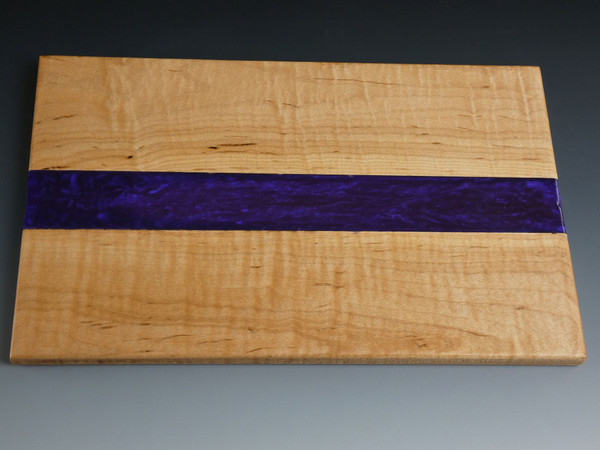 """Maple Small Purple Charcuterie Serving Board #19 This is a solid curly maple charcuterie serving board filled in the center with tinted epoxy. The tint is called Purple Haze.  The board is about 7 ½"""" wide, 12"""" long, and 1/2"""" thick.  This was finished with food safe cutting board oil and a protective cutting board wax."""