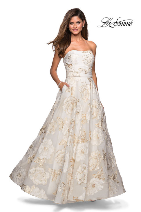 Floral metallic printed A-line prom gown with pockets. Features a strapless neckline and empire waist. Back zipper closure.