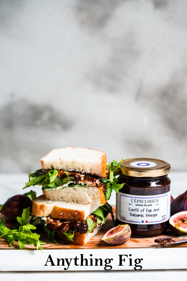 Fig and balsamic vinegar confit next to a sandwich with goat cheese and arugula