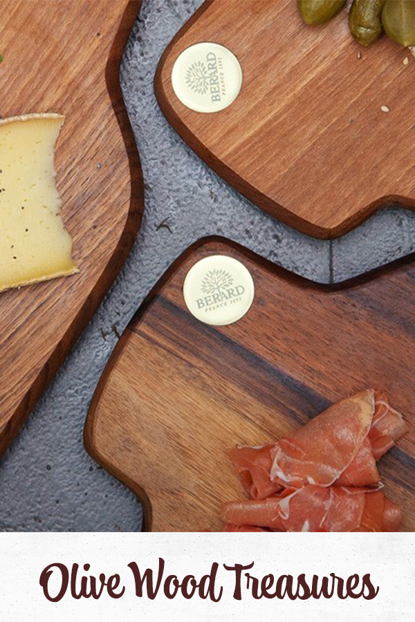 Olive wood boards with food on top of it