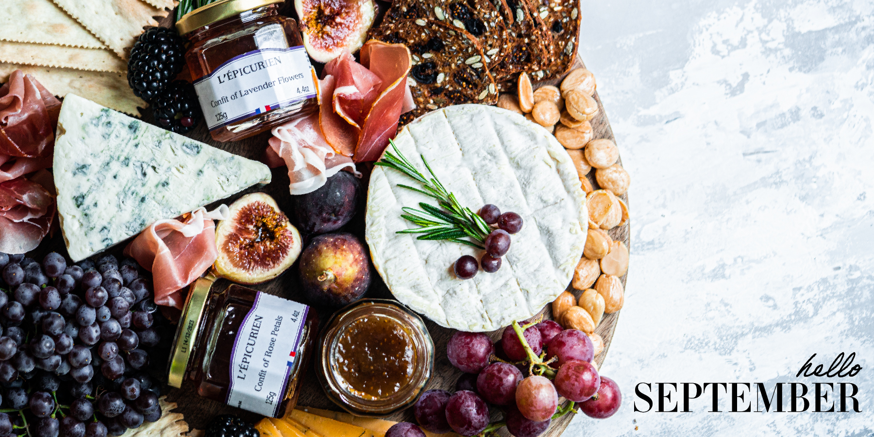 Cheese board with seasonal items like figs with l'epicurien confits for cheese