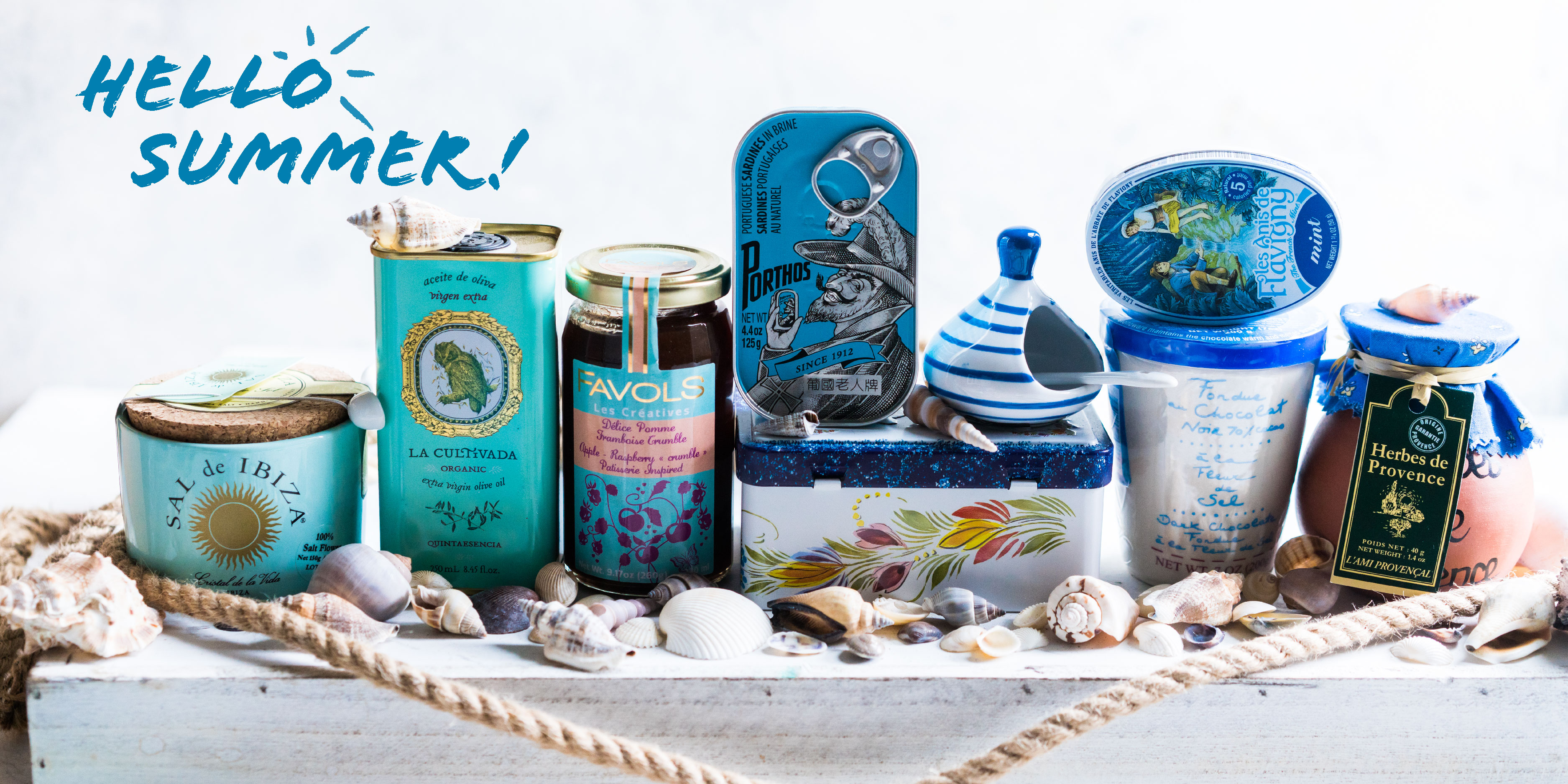 Summer essentials, French beach, european items surrounded by sea shells