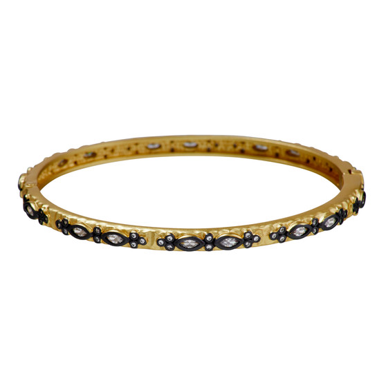 Gold bangle with a two stone paisley pattern