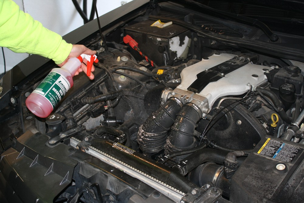 Spray Red Degreaser in Engine Compartment