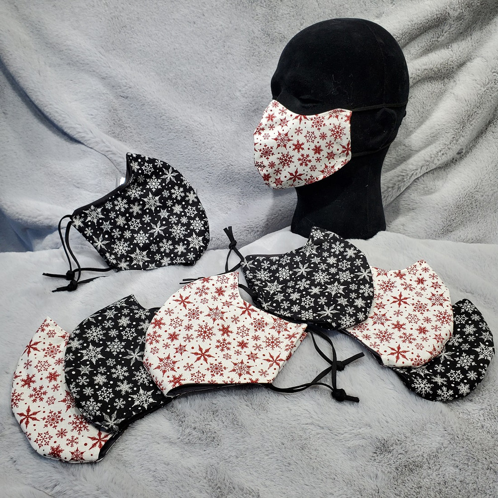 BLIZZARD!  This mask comes in Black with white snowflakes, or White with red snowflakes.