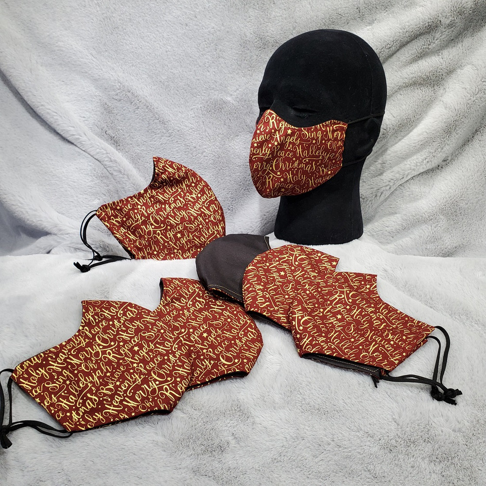 Metallic Gold Holiday Greetings on a Mulberry background color.  Solid black is on the back side of mask.