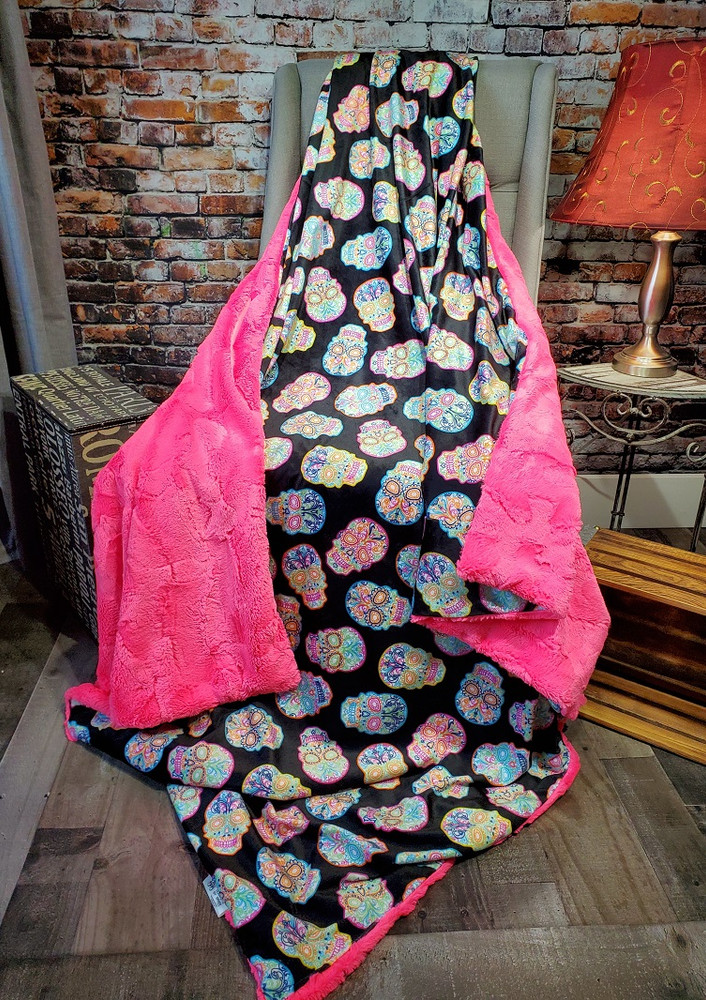 This is an example of Sugar Skulls blanket paired with the Neon Pink in Bella.