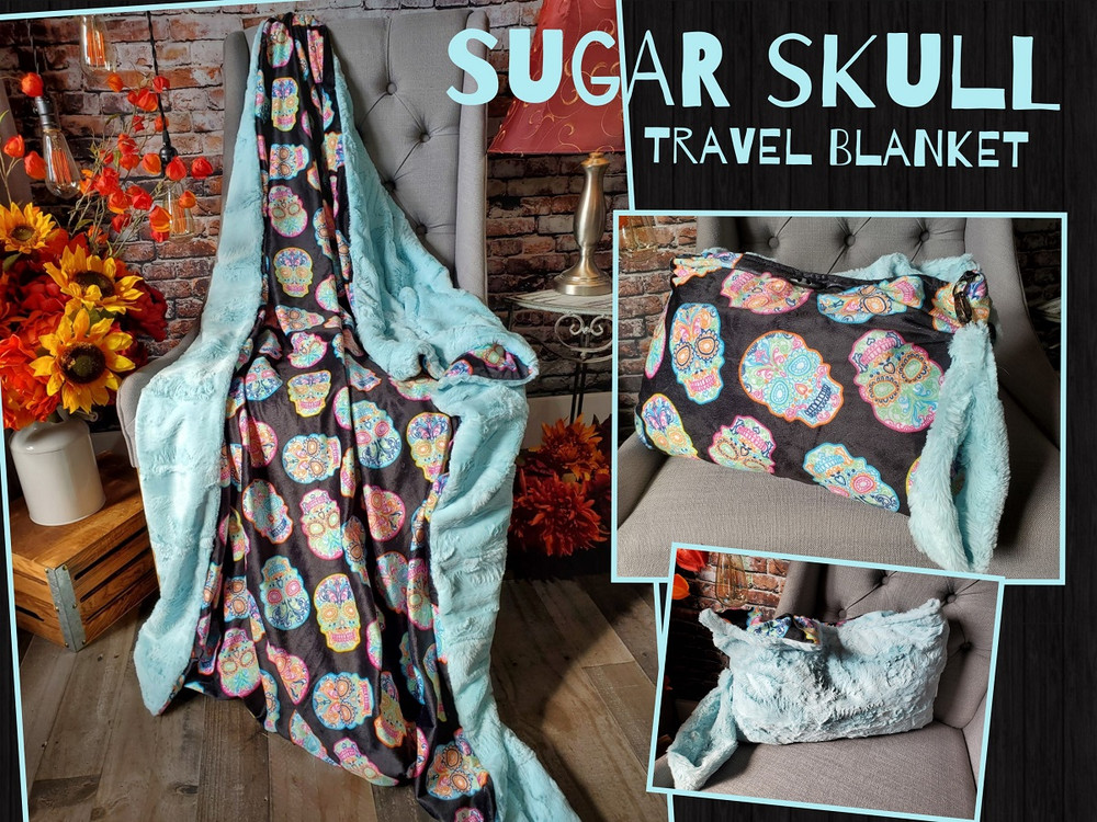 """This is an example of a finished (40"""" x 60"""") Travel Blanket. """"Sugar Skulls"""" on the front, and """"Bella in Seaglass"""" on the back.  Picture shows the """"Travel Handle"""" upgrade."""