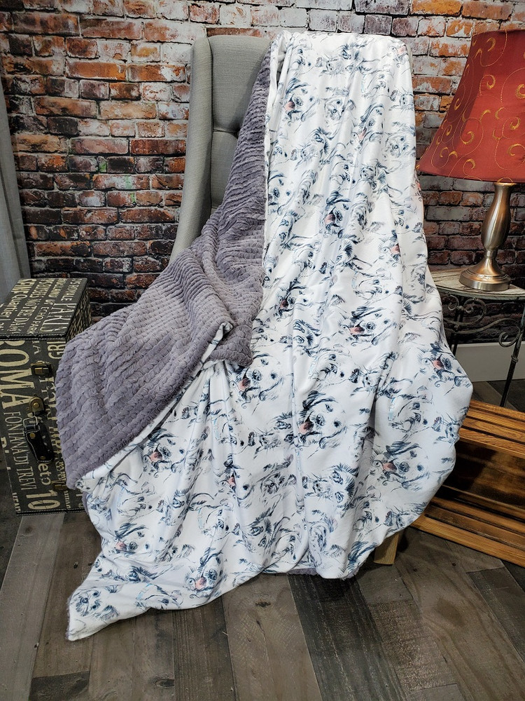 This is an example of a finished Puppy Love blanket, with Hooked Graphite on the back.