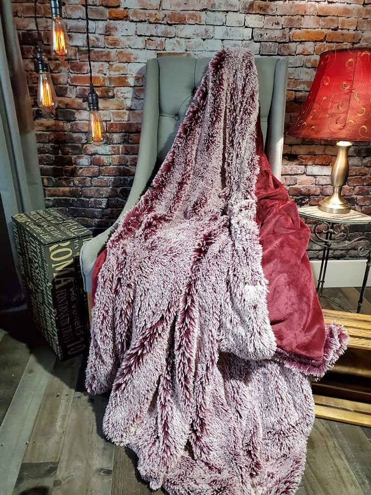 This is an example of a finished Black Cherry w/Frosted White SHAG Blanket,  without the DIVINE Fabric upgrade. It is a light weight coordinating Minky fabric in Merlot.