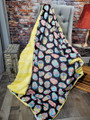 This is an example of Sugar Skulls blanket paired with the Banana Yellow in Bella.