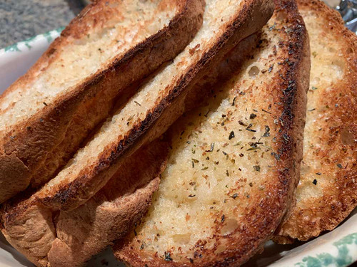 Our Gluten Free Vegan French Loaf is so versatile!   In this photo, we've sliced the loaf into slices, added butter, garlic and seasoning and broil or taste until golden brown.   Compliments any Italian meal.