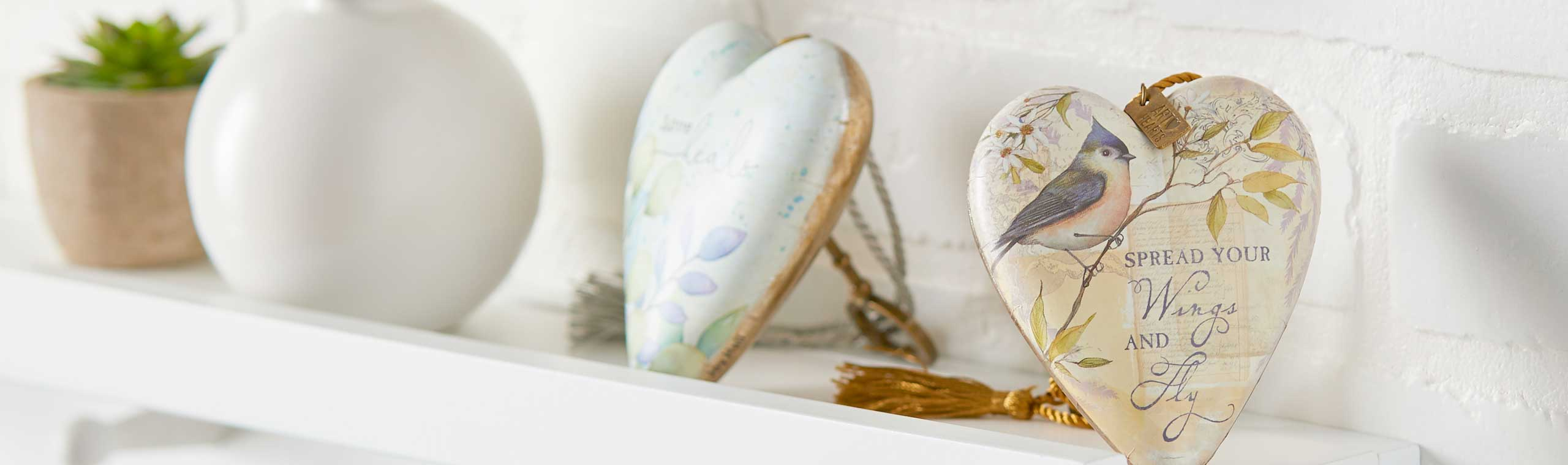 Heart-shaped sculptures sitting on a white shelf