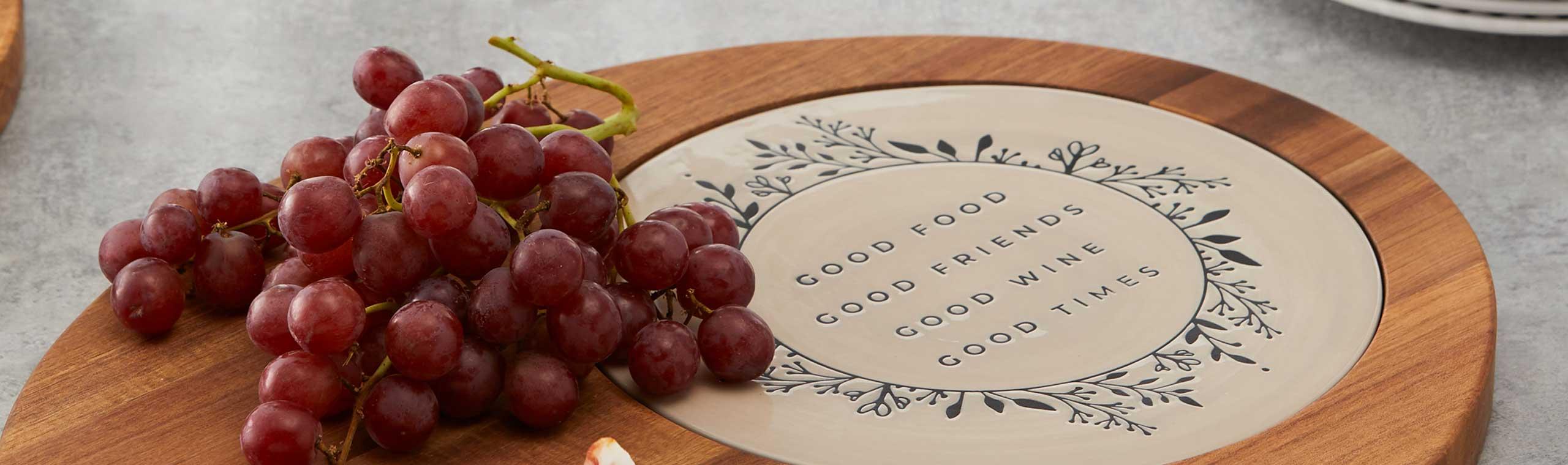 Grape on wood serving platter with ceramic decorative insert