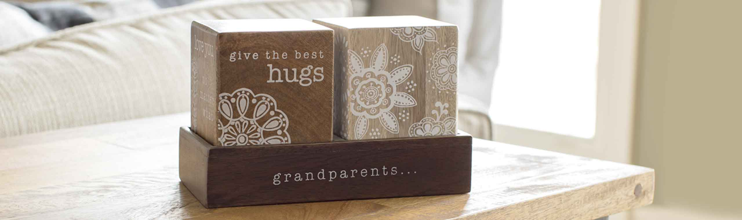 decrative wooden blocks for grandparents with the quote, give the best hugs grandparents