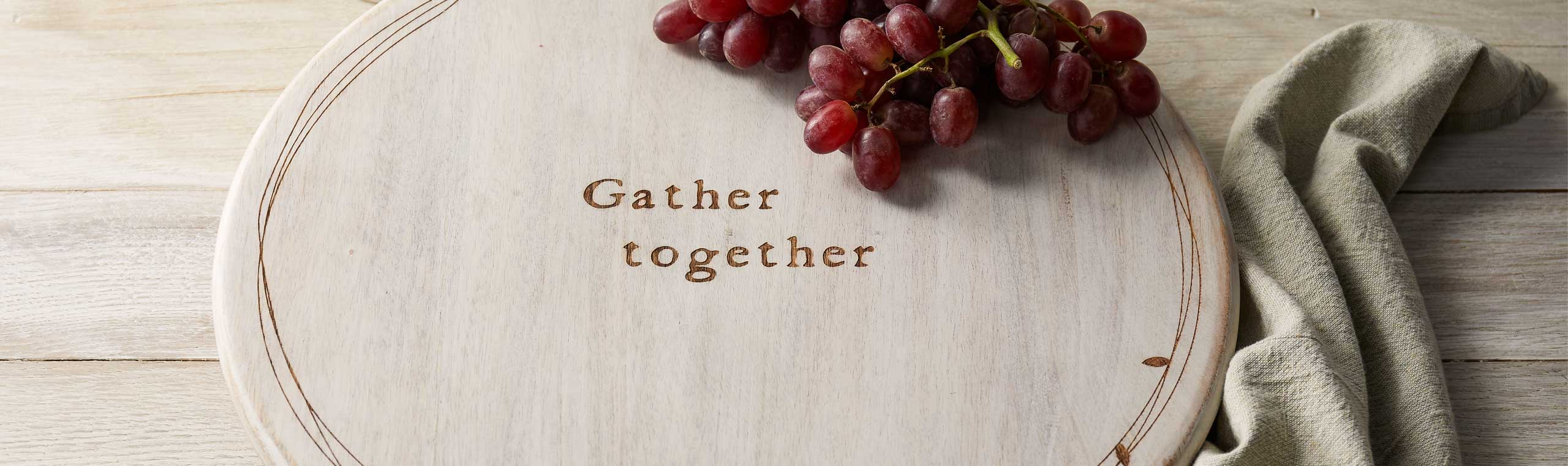 Wood platter engraved with the words Gather Together