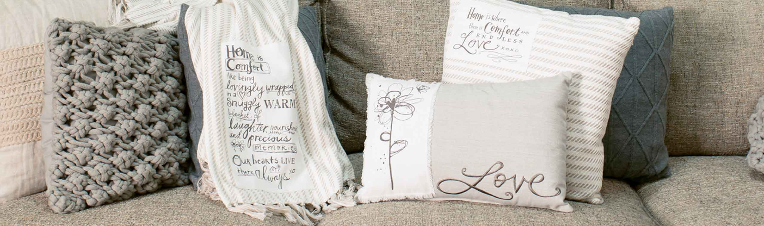 Poetic Thread pillows on a couch