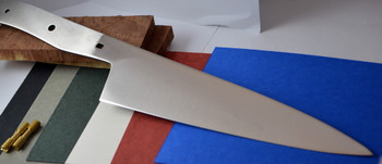 Chef blade shown with different colored spacer material that can be used between the blade and handle scales for contrast.