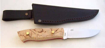 Showing the flat grind EnZo Trapper with Curly Birch Scales
