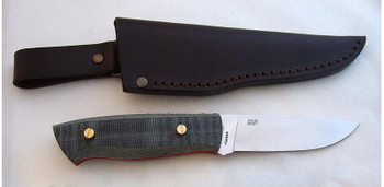 Showing the flat grind Brisa Trapper with Black Canvas Micarta Scales