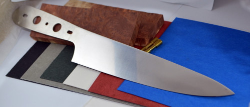 Stainless Steel chef blade shown with Australian hardwood scales in Red Mallee and fibre spacer material colors.