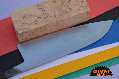 showing the flat back of the chisel-ground Santoku blade