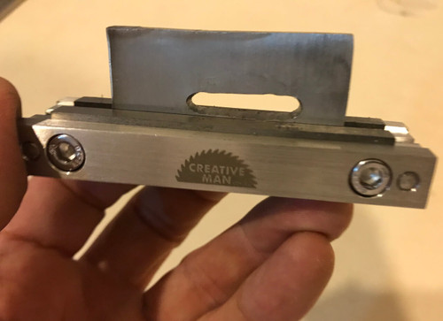 Showing how to use the file guide to file even lines in a guard or bolster. Clamp the guard to your scribed line and the file cannot bite into the carbide, enabling a straight accurate line.  (THIS PHOTO IS OF THE V3)