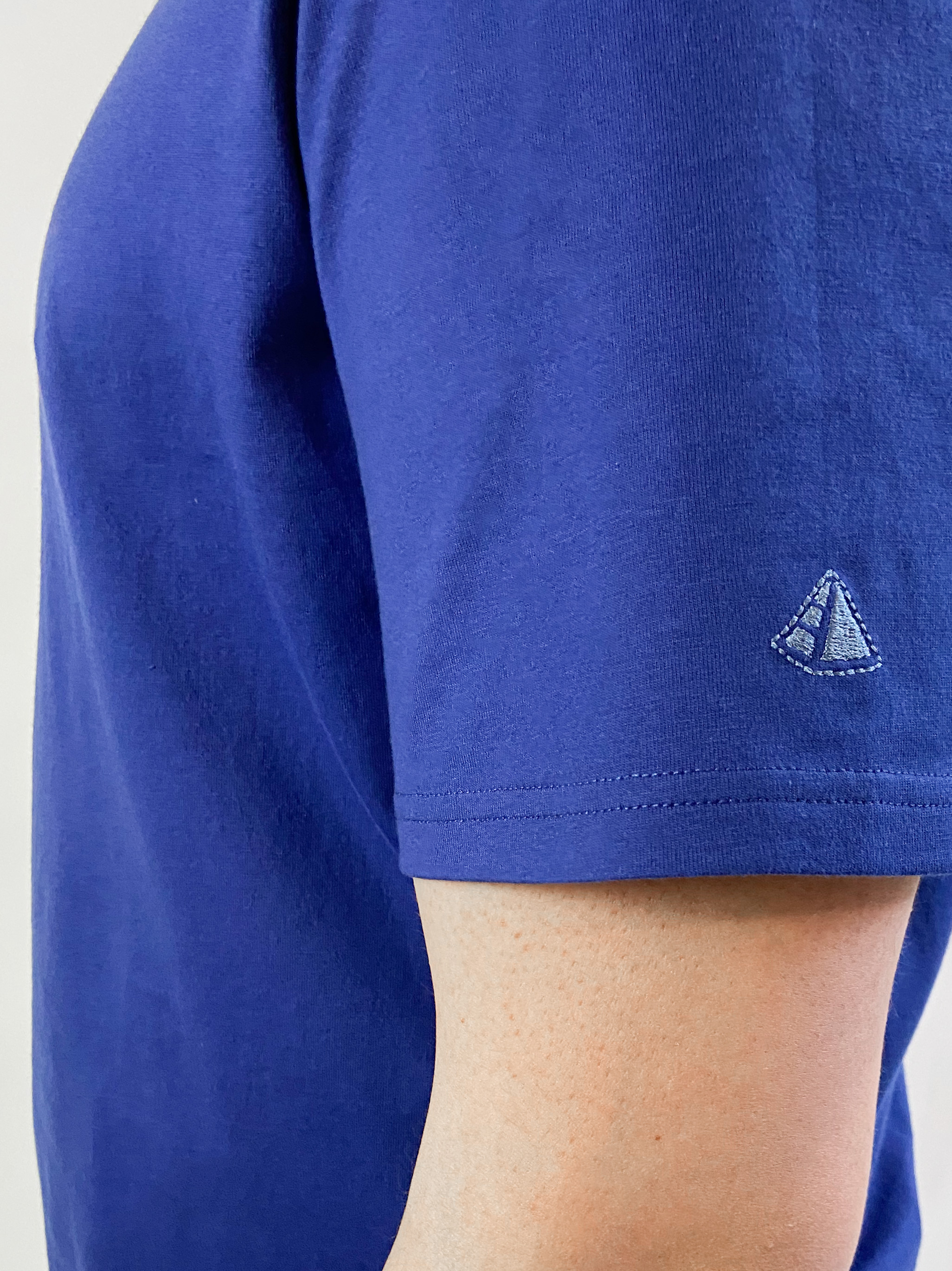 Embroidered Egyptian Cotton Tshirts logo on the sleeve of a T001 T-Shirtg