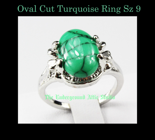 OVAL CUT TURQUOISE   RING SIZE 9