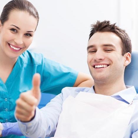 man-giving-thumbs-up-at-dentist-office-depositphotos-opt.jpg