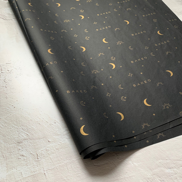 black tissue paper with gold printing