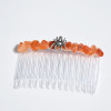 Spider on an Orange Stone Comb