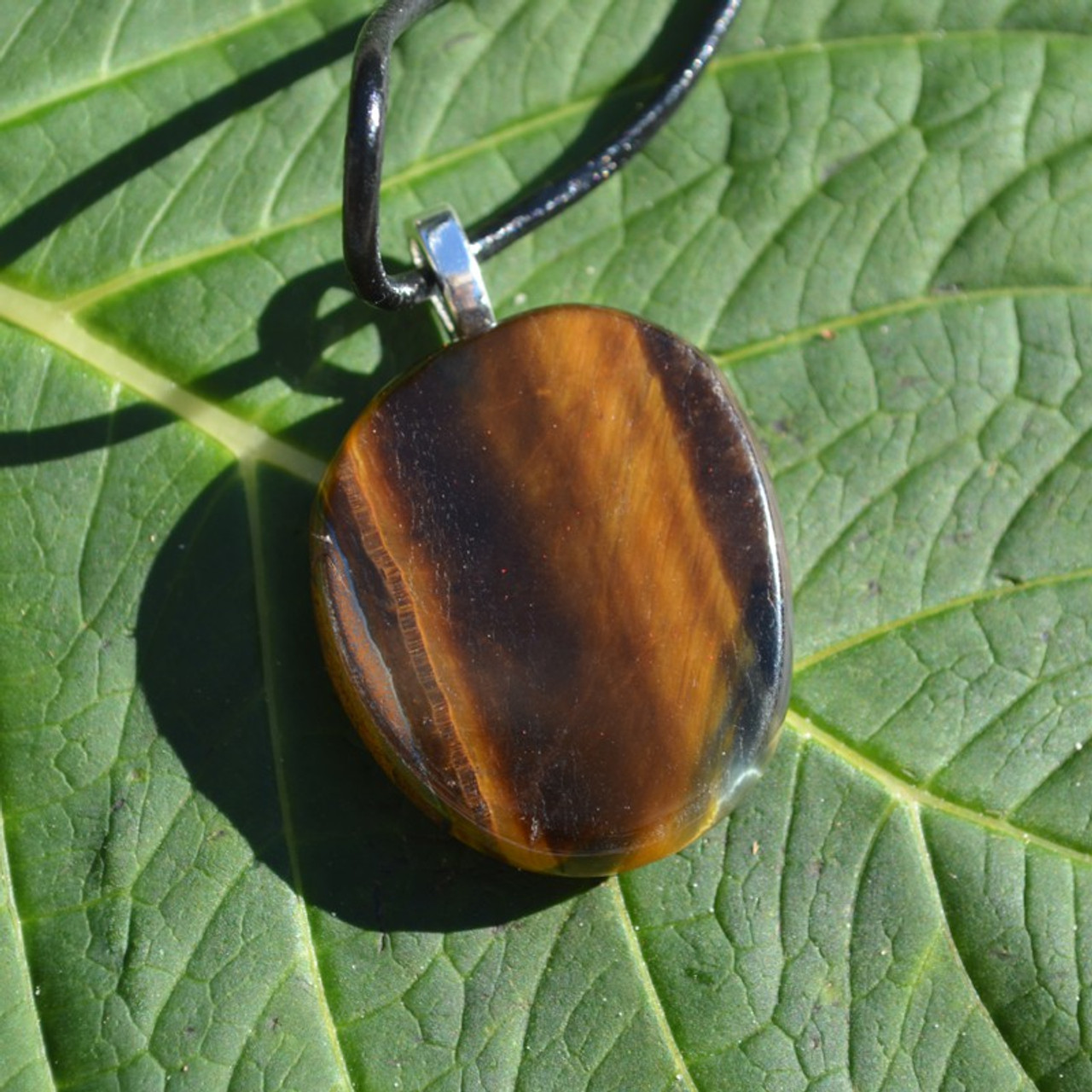 Gold Tiger's Eye Palm Stone Pendant