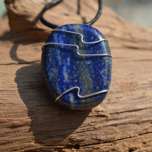 Lapis Lazuli Palm Stone Hand Wire Wrapped on a Leather Thong Necklace