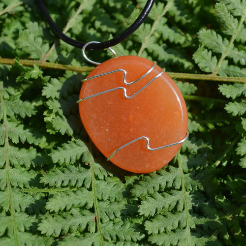 Carnelian Palm Stone Hand Wire Wrapped on a Leather Thong Necklace