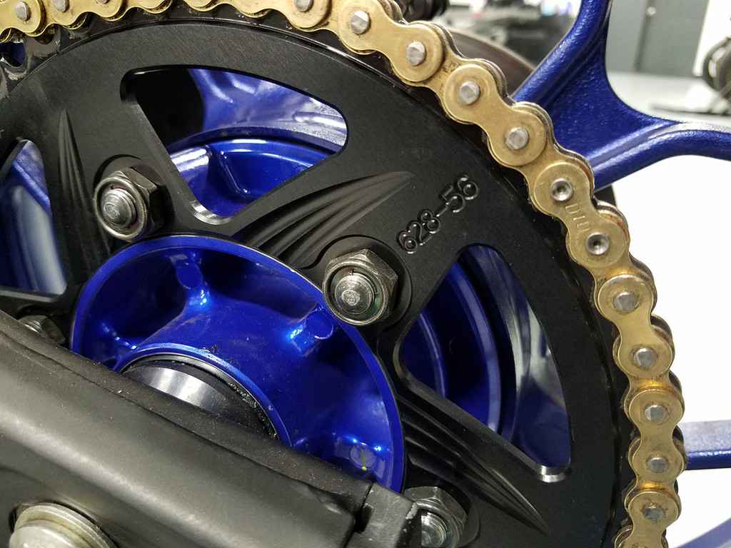 This photo features the short studs, thin lock nut, the DID ERZ chain with rivet link installed on the bike