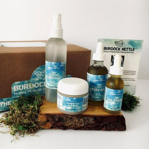 Complete collection of chemical-free, plant-based skincare products with bonus wooden stand